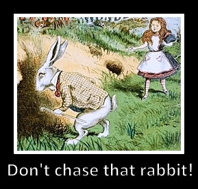 White rabbit going into hole